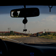 A road to Donetsk, blocked by a bombed railway bridge and a train.