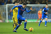 Ollie Rathbone brings the ball forward during the EFL Sky Bet League 1 match between Oxford United and Rochdale at the Kassam Stadium, Oxford, England on 27 November 2018.