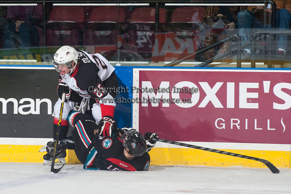 KELOWNA, CANADA - DECEMBER 5: Tate Olson #25 of Prince George Cougars checks Jesse Lees #2 of Kelowna Rockets to the ice on December 5, 2014 at Prospera Place in Kelowna, British Columbia, Canada.  (Photo by Marissa Baecker/Shoot the Breeze)  *** Local Caption *** Tate Olson; Jesse Lees;