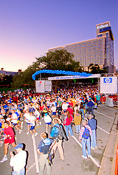 Stock photo of Houston marathon participants running by the Hilton Hotel in downtown Houston