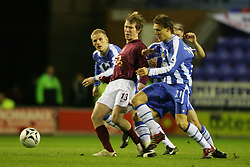 WIGAN, ENGLAND - TUESDAY, JANUARY 10th, 2006: Arsenal's Alexander Hleb breaks through the Wigan Athletic's defense during the League Cup match at the JJB Stadium. (Pic by David Rawcliffe/Propaganda)