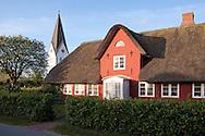 DEU, Germany, Schleswig-Holstein, North Sea,  Amrum island, Frisian house and St. Clemens church in Nebel.<br /> <br /> DEU, Deutschland, Schleswig-Holstein, Nordseeinsel Amrum, Friesenhaus und St. Clemens Kirche in Nebel.