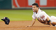 Sep 23, 2015; Houston, TX, USA; Houston Astros second baseman Jose Altuve (27) steals second base against the Los Angeles Angels in the first inning at Minute Maid Park. Mandatory Credit: Thomas B. Shea-USA TODAY Sports