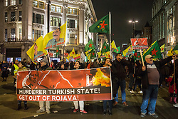 London, UK. 11 October, 2019. Kurdish supporters of the YPG blockade Oxford Circus in protest against Turkey's ground invasion of Kurdish-held areas in northern Syria and to call for the UK to stop supporting the Turkish government. The latest UN reports suggest that 100,000 people have already fled their homes in Northern Syria as a result of the Turkish assault.