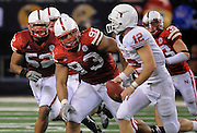 The Big 12 College football championship game, Nebraska vs. Texas at Cowboys Stadium in Arlington, Texas 5 December, 2009.  Nebraska's Ndamukong Suh (93), sets his sights on Texas' Colt McCoy (12), in second quarter action Saturday, December 5, 2009 at Cowboys Stadium.