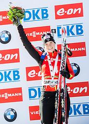 Second placed BESCOND Anais (FRA) celebrates at medal ceremony after the Women 12,5 km Mass Start at day 4 of IBU Biathlon World Cup 2014/2015 Pokljuka, on December 21, 2014 in Rudno polje, Pokljuka, Slovenia. Photo by Vid Ponikvar / Sportida