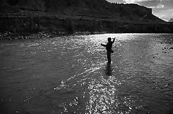 2013 APR 18: Copi Vojta fishes the Roaring Fork River outside of Carbondale, CO.