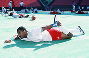 American Football Conference Houston Oilers quarterback (1) stretches at photo day during the week before the 1989 NFL Pro Bowl football game against the National Football Conference on Jan. 24, 1989 in Honolulu. The NFC won the game 34-3. (©Paul Anthony Spinelli)