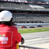 Members of the Daytona safety crew watch as cars practice in front of the front stretch construction during the 57th Annual NASCAR Coke Zero 400 practice session at Daytona International Speedway on Friday, July 3, 2015 in Daytona Beach, Florida.  (AP Photo/Alex Menendez)
