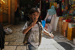A small boy eating an ice cream in the Old City of Jerusalem. From a series of travel photos taken in Jerusalem and nearby areas. Photo date: Thursday, August 2, 2018. Photo credit should read: Richard Gray/EMPICS