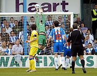 Photo: Olly Greenwood.<br />Colchester United v Leeds United. Coca Cola Championship. 09/04/2007. Colchester's Dean Gerkin tips over Leeds' Jonathan Douglas's shot