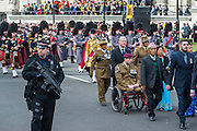Retired/injured soldiers march past. A memorial service, fly and march past for all the forces who fought in Afghanistan is attended by the Royal Family. St Paul's Cathedral, London, UK 13 Mar 2015
