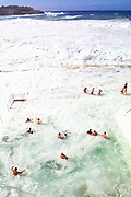 Massive surf conditions turn bondi icebergs white, during the traditional winter weekly swim, Sydney Australia.