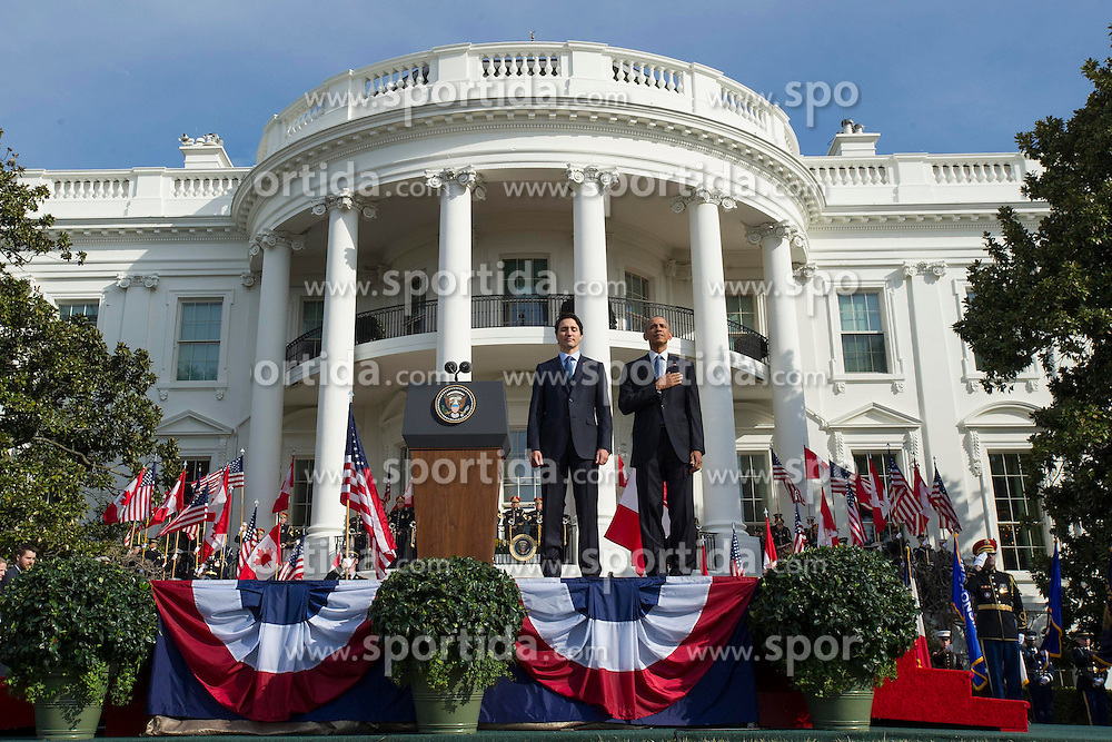 United States President Barack Obama (R) and Canadian Prime Justin Trudeau stand for their national anthems during an arrival ceremony on the South Lawn of the White House, in Washington, D.C. on March 10, 2016. Credit: Kevin Dietsch, Pool via CNP - NO&nbsp;WIRE&nbsp;SERVICE -. EXPA Pictures &copy; 2016, PhotoCredit: EXPA/ Photoshot/ Kevin Dietsch<br /> <br /> *****ATTENTION - for AUT, SLO, CRO, SRB, BIH, MAZ, SUI only*****