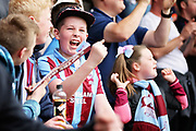 Scunthorpe fans celebrating during the EFL Sky Bet League 1 match between Scunthorpe United and Rotherham United at Glanford Park, Scunthorpe, England on 12 May 2018. Picture by Nigel Cole.