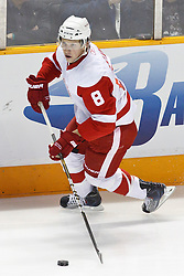 November 30, 2010; San Jose, CA, USA;  Detroit Red Wings left wing Justin Abdelkader (8) skates with the puck against the San Jose Sharks during the first period at HP Pavilion. Detroit defeated San Jose 5-3. Mandatory Credit: Jason O. Watson / US PRESSWIRE