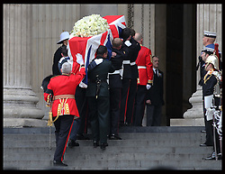 The coffin of Baroness Thatcher is taken up the steps of St.Paul's Cathedral in London at the start of her funeral Wednesday 17th  April 2013 Photo by: Stephen Lock / i-Images