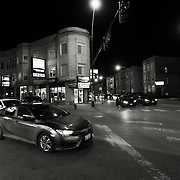 Night time street shot in Chicago's Logan Square neighborhood near California Street Blue Line El Train station.