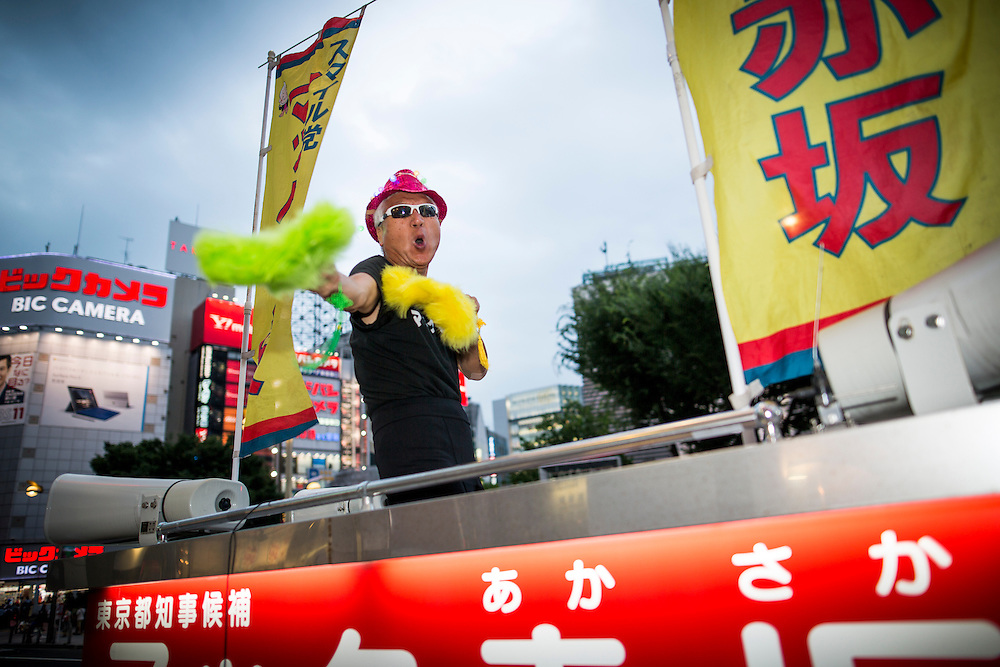 TOKYO, JAPAN - JULY 20 : Mac Akasaka real name Makoto Tonami, is a Japanese businessman and political activist from Smile Party he founded, perform a dance before his campaign speech for the July 31 Tokyo gubernatorial election in Shinjuku, Tokyo, Japan on Wednesday, July 20, 2016.   (Photo: Richard Atrero de Guzman/NUR Photo)