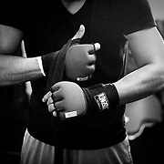 Abner Mares wraps his hands prior to training.