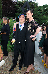 STEPHEN JONES and ERIN O'CONNOR at a party to celebrate Stephen Jones's 25 Years of Millinery held at Debenham House, 8 Addison Road, London W14 on 13th July 2006.<br />