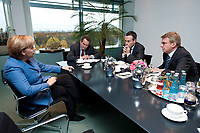 05 NOV 2010, BERLIN/GERMANY:<br /> Angela Merkel, CDU, Federal Chancellor Germany, Quentin Peel, Journalist FT, Lionel Barber, Editor of the FT, Gerrit Wiesmann, Journalist FT, during an interview, in her office Federal Chancellory<br /> Angela Merkel, CDU, Bundeskanzlerin, waehrend einem Interview, in ihrem Buero, Bundeskanzleramt<br /> IMAGE: 20101105-01-0<br /> KEYWORDS: Büro