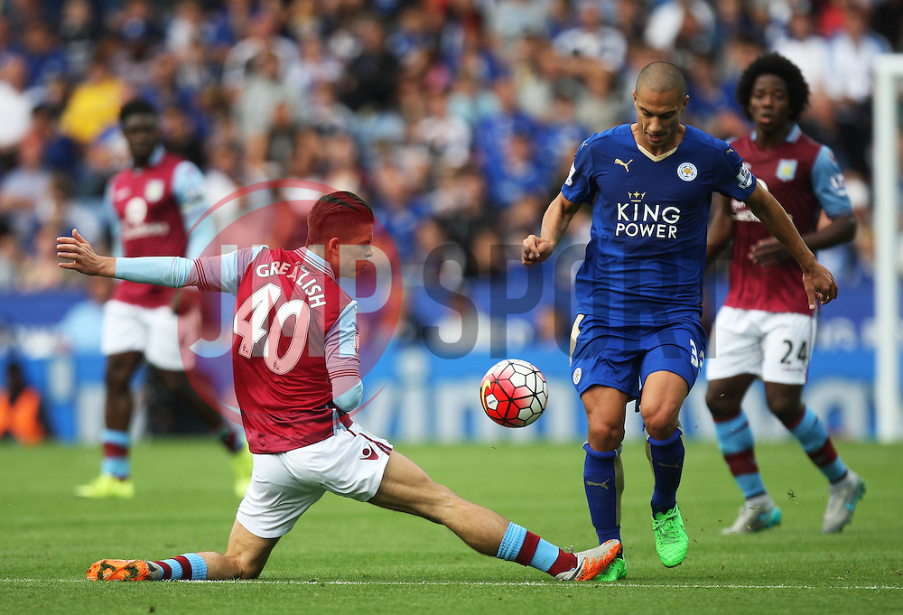 Jack Grealish of Aston Villa (L) and Gokhan Inler of Leicester City in action  - Mandatory byline: Jack Phillips/JMP - 07966386802 - 13/09/2015 - SPORT - FOOTBALL - Leicester - King Power Stadium - Leicester City v Aston Villa - Barclays Premier League