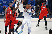 Dallas Mavericks point guard Luka Doncic (77) preforms a no-look pass against Toronto Raptors while being guarded by Toronto Raptors  forward OG Anunoby (3), Pascal Siakam (43) and  Marc Gasol (33) during an NBA basketball game, Saturday, Nov. 16, 2019, in Dallas. The Mavericks defeated the Raptors 110-102. (Wayne Gooden/Image of Sport)