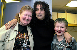 Sheffield Star Competition winners Michelle and Mattheu (correct spelling) Miller of Thorn in Doncaster back stage with the gentle man of Rock Alice Cooper<br />
