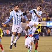 Nicolas Otamendi, (left) and Sergio Aguero, Argentina, challenge for a corner kick during the Argentina Vs Ecuador International friendly football match at MetLife Stadium, New Jersey. USA. 31st march 2015. Photo Tim Clayton