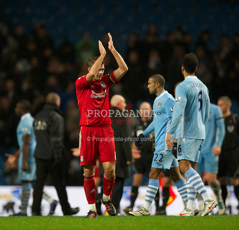 MANCHESTER, ENGLAND - Tuesday, January 3, 2012: Liverpool's captain Steven Gerrard dejected after his side's 3-0 defeat by Manchester City during the Premiership match at the City of Manchester Stadium. (Pic by David Rawcliffe/Propaganda)
