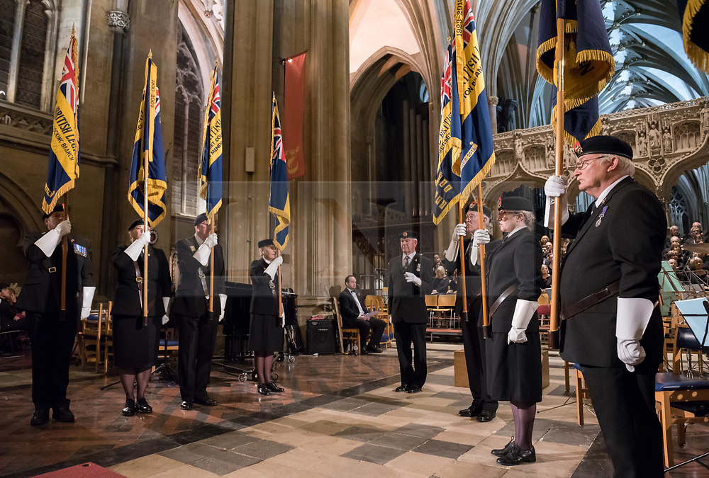 © Licensed to London News Pictures. 10/11/2018. Bristol, UK. The Royal British Legion Festival of Remembrance 1918-2018 at Bristol Cathedral. On the eve of the Centenary of the end of the First World War the Royal British Legion holds a special Festival of Remembrance in Bristol Cathedral, bringing together musical talent from across the region presenting a poignant tribute from a variety of local performers. The second part of the evening will crescendo with a performance of Karl Jenkins' The Peacemakers by the 120 Members of Lucis and Noctis Choirs and the Southern Sinfonia Orchestra directed by Francis Faux. The piece is dedicated to all those who have lost their lives during armed conflict. During WW1 Soldiers from all over the World from numerous Continents, Commonwealth Countries and Nations Worldwide of all faiths castes creeds and religions served fought and died for Britain. The British Empire's colonies sent over two and a half million men to fight for Britain during the war, and 400,000 Muslims fought for Great Britain. The Lord Mayor Cleo Lake with Kizzy Morell represents the 60,000 Black South Africans, 15,600 Caribbean and 120,000 Africans who fought in WW1.<br /> Babbi Channa represents the 100,000 Sikhs, One million Indians who fought in WW1<br /> Chinese lady; Represents 140,000 Chinese Labour Corps Members<br /> Muslim lady; Representing the 400,000 Muslims who fought in WW1<br /> Nepalese lady; Representing the 90,000 Ghurkhas who fought in WW1<br /> (Last three representatives pupils from Badminton School )<br /> Photo credit: Simon Chapman/LNP