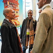 Tall Order TEDx Seattle 2018. Anastacia-Renee (poet) in front of Jeff Mihalyo artwork. Photo by Alabastro Photography.