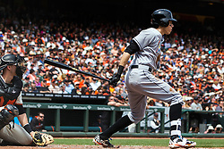 SAN FRANCISCO, CA - APRIL 24: Christian Yelich #21 of the Miami Marlins hits into a fielder's choice to score a run against the San Francisco Giants during the fifth inning at AT&T Park on April 24, 2016 in San Francisco, California.  (Photo by Jason O. Watson/Getty Images) *** Local Caption *** Christian Yelich