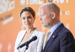 Angelina Jolie today joined UK Foreign Secretary William Hague to launch the summit to End Sexual Violence in Conflict at London\'s Excel Centre. Image ©Licensed to i-Images Picture Agency. 10/06/2014. London, United Kingdom. Angelina Jolie. the Excel Centre. Picture by i-Images