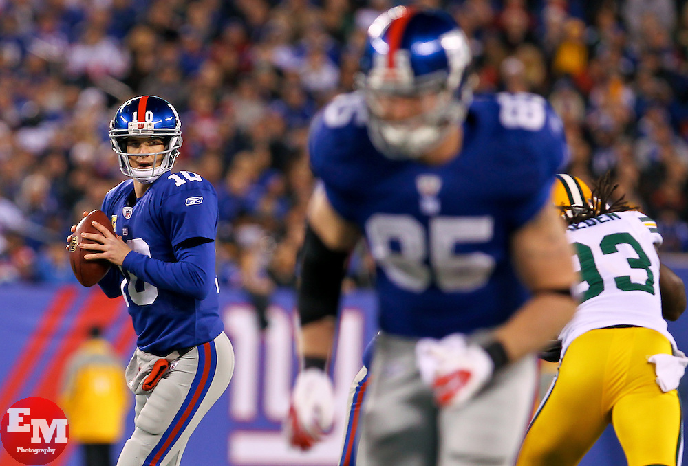 Dec 4, 2011; East Rutherford, NJ, USA; New York Giants quarterback Eli Manning (10) looks to pass to New York Giants tight end Jake Ballard (85) during the first half at MetLife Stadium.