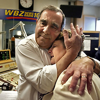 The last broadcast of Gil Santos, longtime sports reporter at WBZ radio. Moments after signing off for the last time, Gil hugs Roberta Santos, his wife of 47 years, while surrounded by their family.
