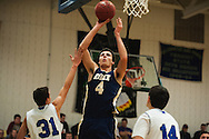 Essex's Eli DiGrande (4) leaps to take a shot during the boys basketball game between the Essex Hornets and the Colchester Lakers at Colchester High School on Tuesday night December 15, 2015 in Colchester. (BRIAN JENKINS/for the FREE PRESS)