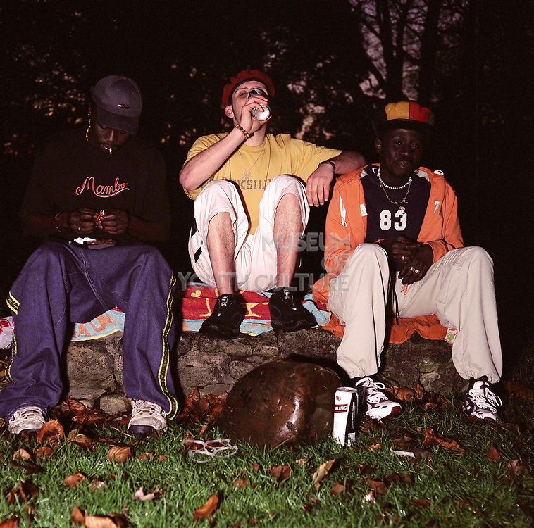 Group of boys drinking in the park, Cardiff 2000's