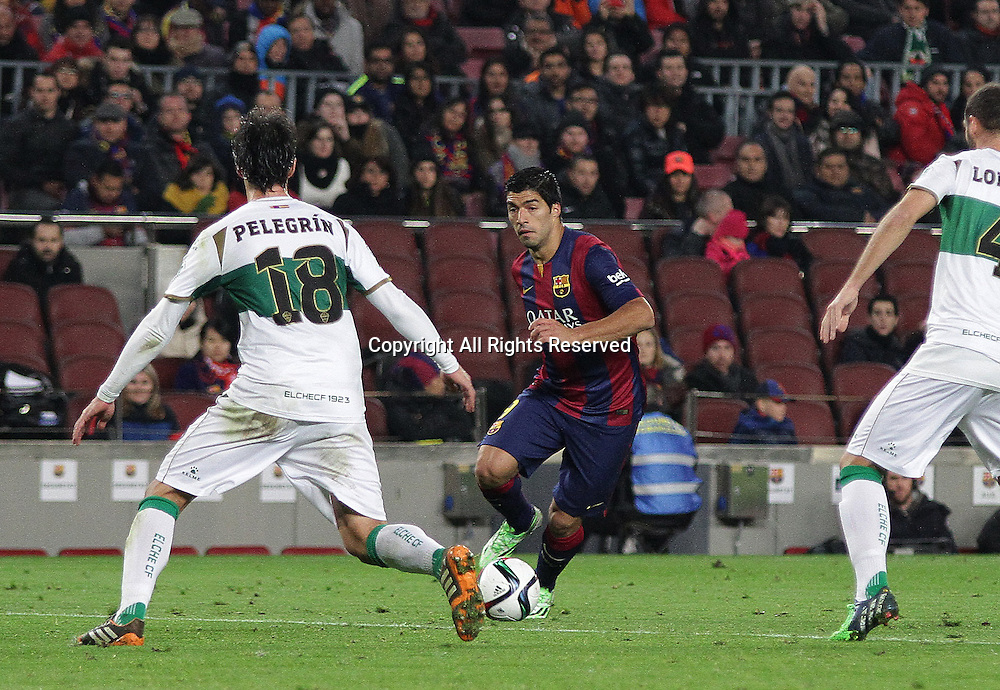 08.01.2015. Barcelona, Spain. Copa del Rey. Barcelona versus Elche CF. Suarez in action during the match covered by Pelegrin of Leche