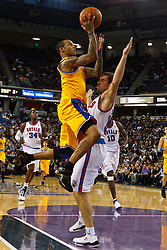March 14, 2011; Sacramento, CA, USA;  Golden State Warriors shooting guard Monta Ellis (8) is fouled by Sacramento Kings point guard Beno Udrih (19) during the second quarter at the Power Balance Pavilion.