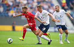 PRESTON, ENGLAND - Saturday, July 19, 2014: Liverpool's Fabio Borini in action against Preston North End's Ben Davies during a preseason friendly match at Deepdale Stadium. (Pic by David Rawcliffe/Propaganda)