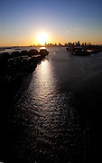 Aerial of Miami ship channel at sundown, Silhouette of Miami skyline in setting sun
