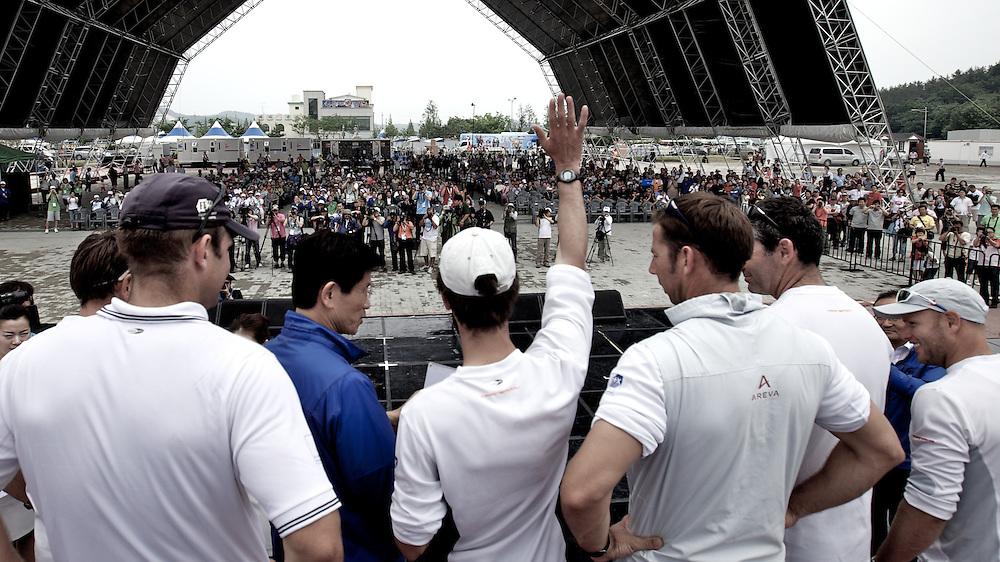 Mr Kim Moon Soo, Governor, Gyeonggi Province (blue jacket), Mathieu Richard (white cap), and French Match Racing Team winners of the Korea Match Cup 2010. World Match Racing Tour. Gyeonggi, Korea. 13th June 2010. Photo: Ian Roman/Subzero Images.