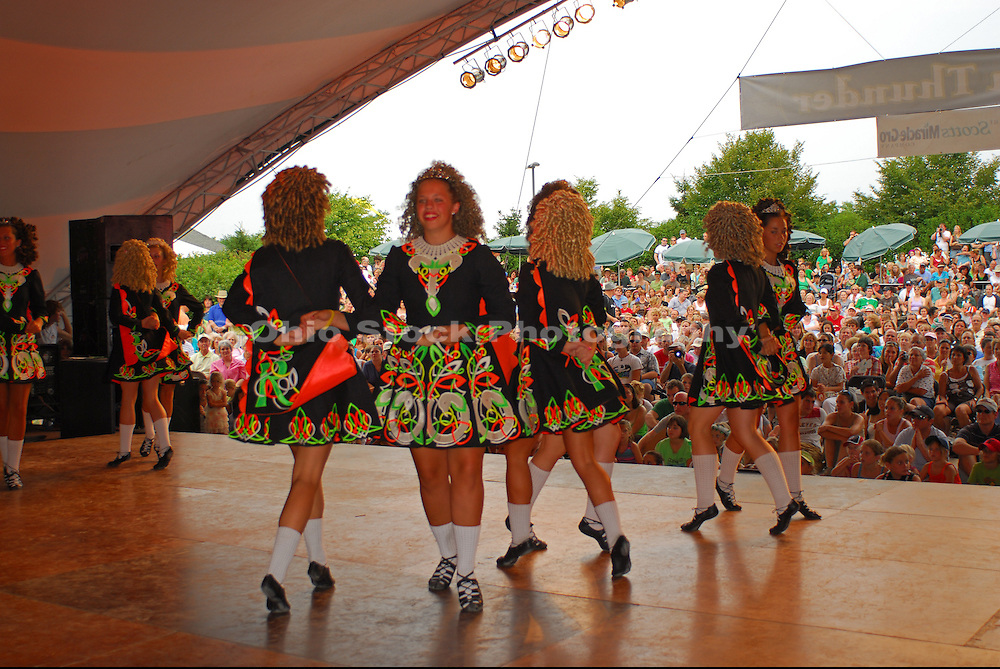 Photo of Irish Dancers onstage in front of a crowd at the Dublin Irish Festival in Dublin, Ohio.