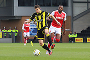 Burton Albion midfielder John Mousinho wins the ball ahead of Fleetwood Town forward Shola Ameobi during the Sky Bet League 1 match between Burton Albion and Fleetwood Town at the Pirelli Stadium, Burton upon Trent, England on 12 March 2016. Photo by Aaron  Lupton.