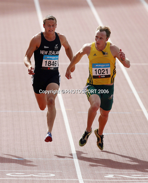 Brent Newdick (NZL) and Allan Richard (AUS) compete in the Decathlon 100M sprint on Day 5 of the XVIII Commonwealth Games at the Exhibition Centre, Melbourne, Australia on Monday 20 March, 2006. Photo: Hannah Johnston/PHOTOSPORT<br />