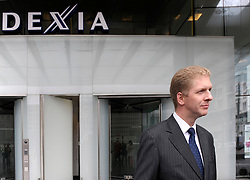 Axel Miller, chief executive officer of the Dexia Group, speaks to members of the media at the Dexia Bank headquarters building in Brussels, Belgium, on Tuesday, Sept. 30, 2008. Belgium and France threw Dexia SA a 6.4 billion-euro ($9.2 billion) lifeline and the chairman and chief executive officer stepped down as the widening financial crisis forced governments to prop up institutions across Europe.  Photo © Jock Fistick)
