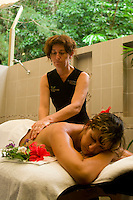 A young woman receives a relaxing massage and spa treatment at the Daintree Eco Lodge & Spa, far north Queensland, Australia.
