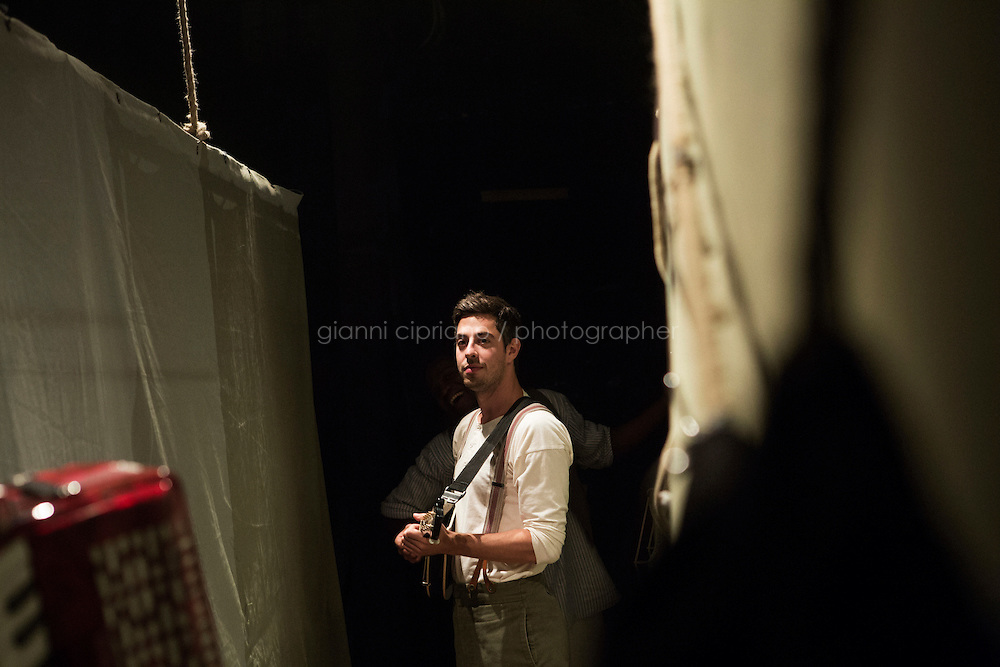 SLIEMA, MALTA - 8 FEBRUARY 2016: Actor Matthew Romain waits backstage before entering the scene of touring Hamlet, performed by the Shakespeare's Globe theatre company, at the Salesian Theatre in Sliema, Malta, on February 8th 2016.<br /> <br /> The touring Hamlet, performed by the Shakespeare's Globe theatre company, is part of the Globe to Globe tour that set off in April 2014 (on the 450th anniversary of Shakespeare's birth) with the ambitious intention of visiting every country in the world over 2 years. The crew is composed of a total of sixteen men and women: four stage managers and twelve twelve actors  actors perform over two dozen parts on a stripped-down wooden stage. So far Hamlet has been performed in over 150 countries, to more than 100,000 people and travelled over 150,000 miles. The tour was granted UNESCO patronage for its engagement with local communities and its promotion of cultural education. Hamlet was also played for many dsiplaced people around the world. It was performed in the Zaatari camp on the border between Syria and Jordan, for Central African Republic refugees in Cameroon, and for Yemeni people in Djibouti. On February 3rd it was performed to about 300 refugees in Calais at the camp known as the Jungle.